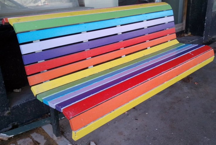 Brightly coloured seat painted in a rainbow of colours, Princes Street, Dunedin, New Zealand. Taken by Liz on Monday 21 May, 2018